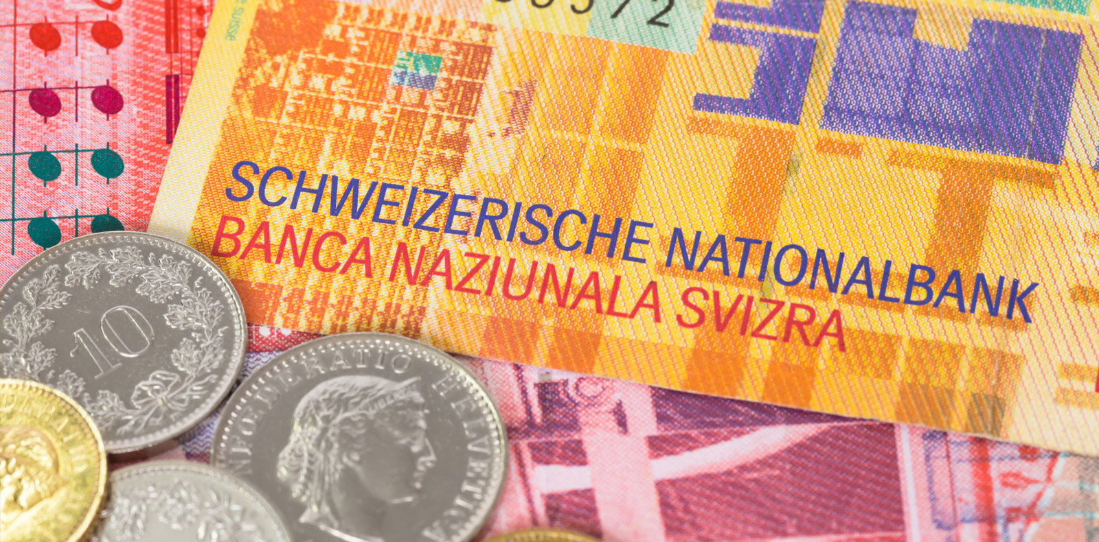 Switzerland prints and spends more currency